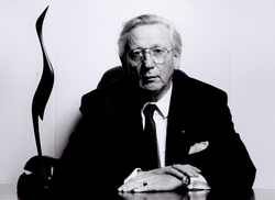 Ernst-Richard Matthiensen, chief executive of one of the first IFSC banks,<br /> Dresdner, with a 5,600 year old bog oak sculpture, presented to him by the<br /> then Minister for Finance, Ruairi Quinn, in 1995 as a recognition by Ireland<br /> of the seminal role he had played in bringing his own and other German<br /> financial institutions to the IFSC