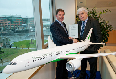 Peter Barrett, CEO, SMBC Aviation Capital receiving the M&A Deal of the Year from Ken O'Brien, editor, <i>Finance Dublin</i>.