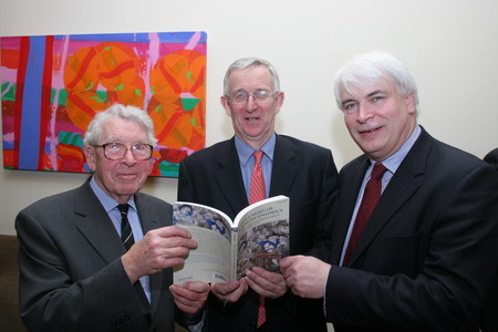 Prof. Louden Ryan (L-R) pictured in 2009 at the launch of Antoin E. Murphy's book <i>The Genesis of Macroeconomics</i> in Trinity College, and Ken O'Brien, Editor, <i>Finance Dublin</i>