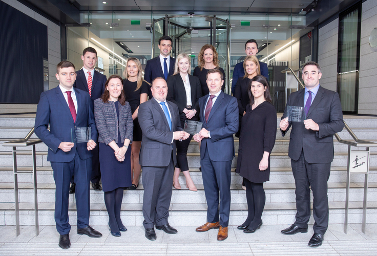 Some of Walkers' Finance and Capital Markets team pictured with the team's three Finance Dublin Deals of the Year 2019 including: Deal of the Year Financial Services, Securitisation: Auto Loans - Kimi 7: Finnish Auto Loan Securitisation - Santander Consumer Finance; Deal of the Year Debt Capital Markets: Auto Securitisation - Citizen Irish Auto Receivables Trust 2018 - First Citizen; and a further Deal of the Year Debt Capital Markets: Repackaging (Carbon Offsets) - Tramontana Asset Management. Walkers Asset Finance team won a fourth award for Deal of the Year Aviation Finance: Joint Venture Platform - Airborne Capital/AltitudeOne Aviation<br />